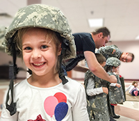 Girl smiling with Vet's helmet
